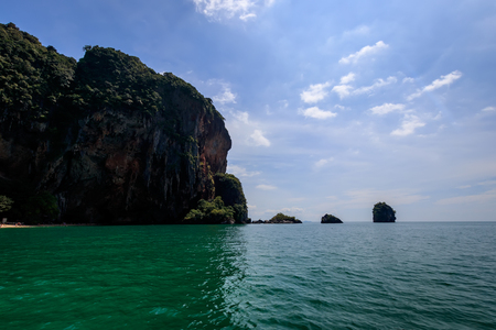 Riley beach with golden sand, karst rocks and turquoise sea on a sunny day. Province of Krabi, Thailand. Landscape. View of the cave of fertility. 写真素材