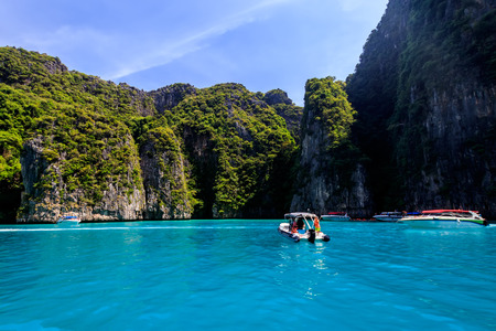 Karst rocks and turquoise sea in the bay of Phi Phi islands on a sunny summer day. Landscape. Province of Krabi, Thailand.