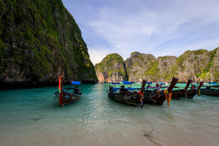 Maya Bay, Thailand, Krabi  - November 20, 2017: island of Phi Phi in a summer sunny day with karst rocks, boats, people and turquoise sea. Landscape.