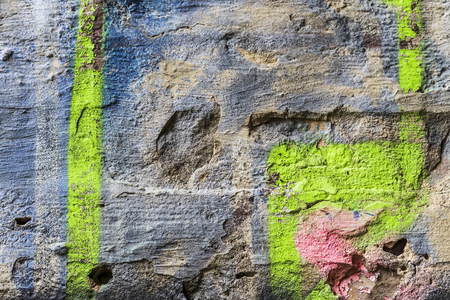 Fragment of colored graffiti painted on a brick wall. Texture. Abstract background for design.