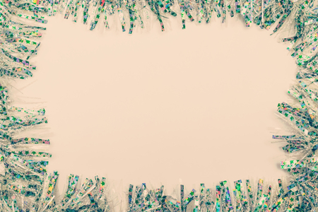 Christmas and New Year holiday background. Tinsel isolated on white. Top view. Copy space. Flat lay.