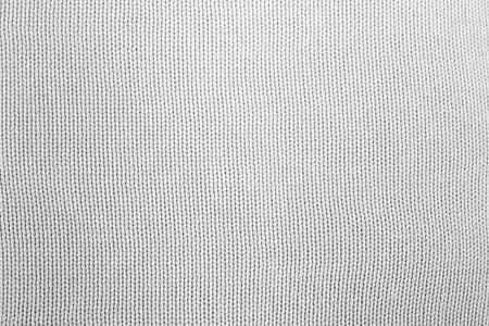 Texture of cloth material for design. Abstract background with white, black and gray threads of woven.