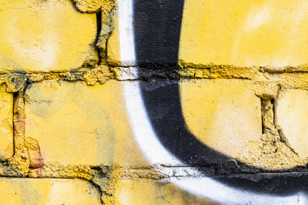 Fragment of colored graffiti painted on a brick wall. Texture. Abstract background for design. Stockfoto - 111673444