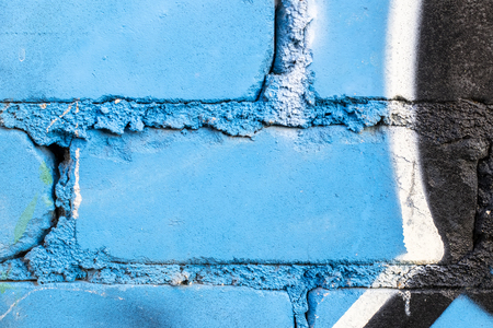 Fragment of colored graffiti painted on a brick wall. Texture. Abstract background for design. Stockfoto - 111673451