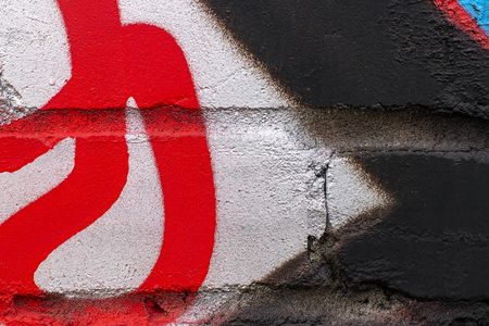 Fragment of colored graffiti painted on a brick wall. Texture. Abstract background for design. Stockfoto - 111673529