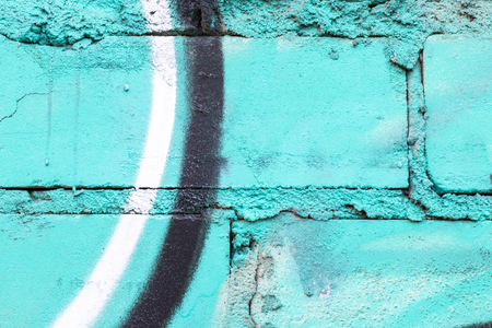 Fragment of colored graffiti painted on a brick wall. Texture. Abstract background for design. Stockfoto - 111673542