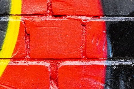 Fragment of colored graffiti painted on a brick wall. Texture. Abstract background for design. Stockfoto - 111674091