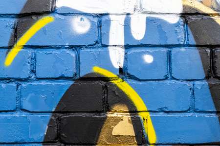 Fragment of colored graffiti painted on a brick wall. Texture. Abstract background for design. Stockfoto - 111674311