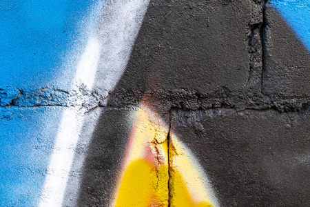 Fragment of colored graffiti painted on a brick wall. Texture. Abstract background for design. Stockfoto - 111674749