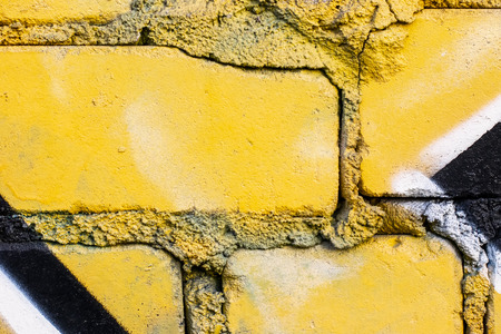 Fragment of colored graffiti painted on a brick wall. Texture. Abstract background for design. Stockfoto - 111674758
