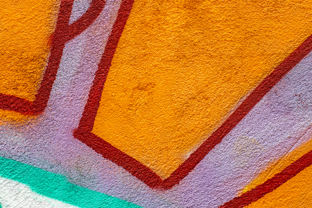 Fragment of colored graffiti painted on a concrete wall. Texture. Abstract background for design. Standard-Bild