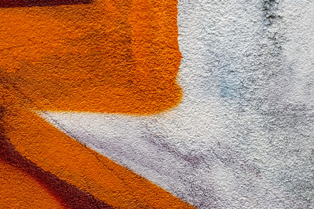 Fragment of colored graffiti painted on a concrete wall. Texture. Abstract background for design. 免版税图像