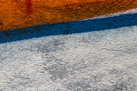 Fragment of colored graffiti painted on a concrete wall. Texture. Abstract background for design. Stock fotó