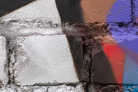 Fragment of colored graffiti painted on a brick wall. Texture. Abstract background for design. Stockfoto - 111674908