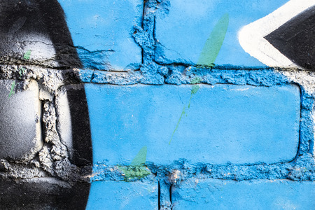 Fragment of colored graffiti painted on a brick wall. Texture. Abstract background for design. Stockfoto - 111675024