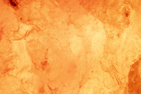 Glowing orange salt lamp texture. Abstract background for design.