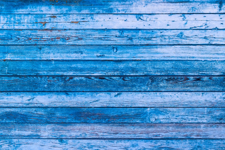 Blue texture of a board with peeling paint. Abstract background for design. Table or wall panel. Фото со стока
