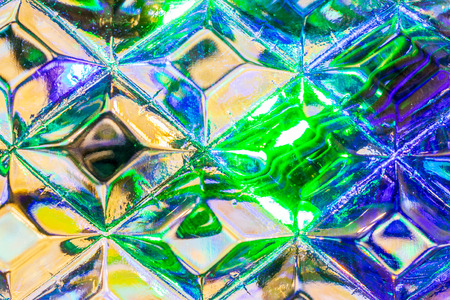 Lights of garland, reflected in the crystal. Glowing texture. Abstract background for design.