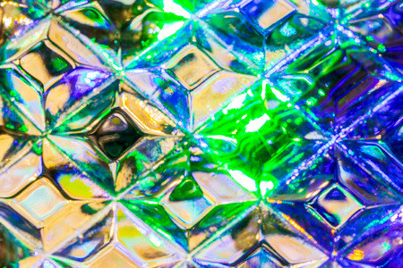 Lights of garland, reflected in the crystal. Glowing texture. Abstract background for design. Archivio Fotografico