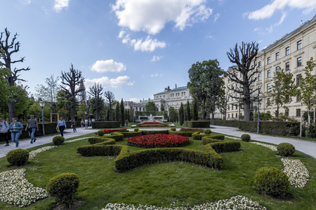 VIENNA, AUSTRIA - APRIL 22, 2019: Beautiful park with flowers, lawns and trees on a sunny spring day in the center of city. Editorial