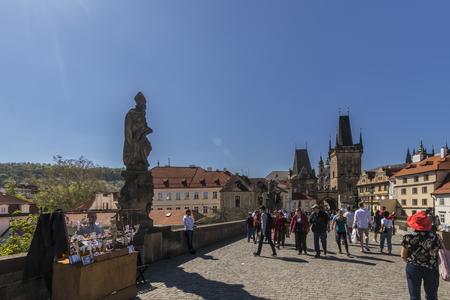 PRAGUE, CZECH REPUBLIC - APRIL 21: A view along Charles Bridge in Prague towards Old Town.