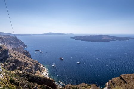 Thira city on Santorini island on a clear sunny day. Cliff overlooking the sea and the caldera.