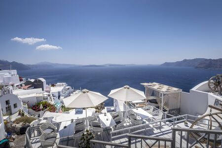 Oia city on Santorini island on a clear sunny day. Cliff overlooking the sea and the caldera. Greece.