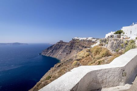 Thira city on Santorini island on a clear sunny day. Cliff overlooking the sea and the caldera. Greece.