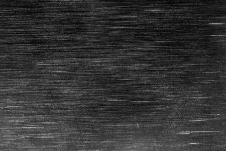Black metal texture with white scratches. Abstract noise black background overlay for design.
