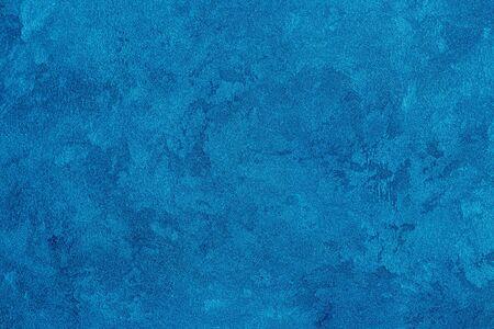 Textur aus blauem dekorativem Putz oder Stuck. Abstrakter Hintergrund für Design. Kunst stilisiertes Banner mit Kopienraum für Text.