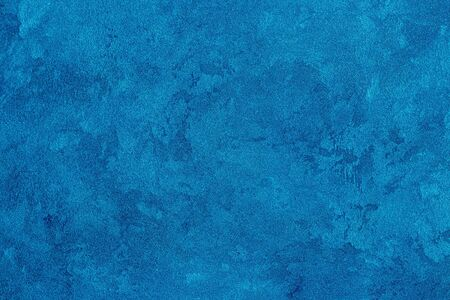Texture of blue decorative plaster or stucco. Abstract background for design. Art stylized banner with copy space for text.