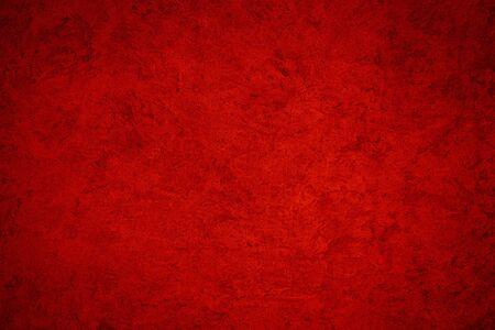 Texture di intonaco decorativo rosso o cemento. Sfondo astratto per il design. Banner stilizzato d'arte con copia spazio per il testo.