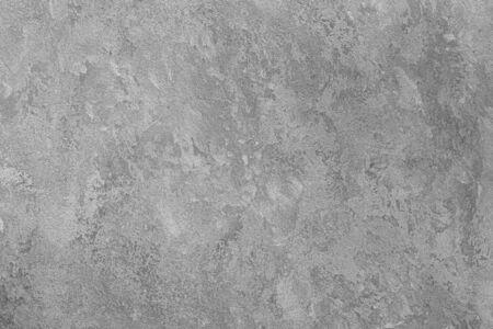 Texture di intonaco decorativo grigio o cemento. Sfondo astratto per il design. Banner stilizzato d'arte con copia spazio per il testo.