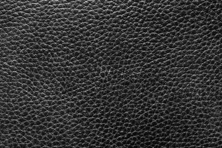Black natural leather texture. Abstract background for design. Art stylized banner. Фото со стока