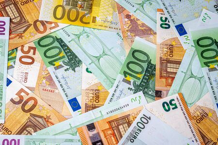 Background from euro banknotes. The concept of wealth and prosperity. Abstract backdrop for design.