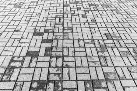 Top view on gray paving stone road. Old pavement of granite texture. Street cobblestone sidewalk. Abstract backdrop for design.