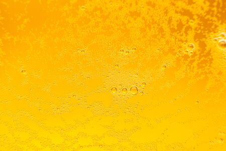 Texture of foam in light beer. Abstract background for design.