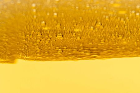 Texture of foam and gas bubbles in light beer. Abstract background for design. Foto de archivo
