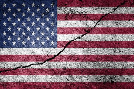 USA flag on cracked concrete wall. The concept of crisis, default, economic collapse, pandemic, conflict, terrorism or other problems in the country. Abstract disaster symbol.