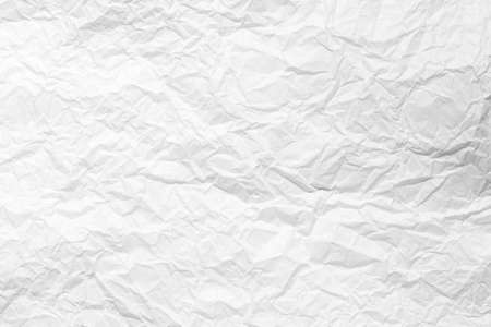Texture of crumpled white parchment or paper. Abstract background for design. Blank with copy space for a text.
