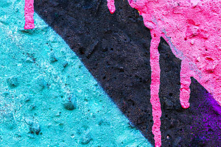 Fragment of colored graffiti painted on a wall. Bright abstract background for design. Spray urban pictures. 版權商用圖片