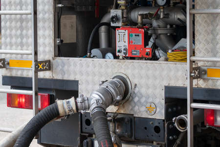 Rescue equipment of a fire engine with inscriptions in Russian. Pumps and hoses . Stockfoto