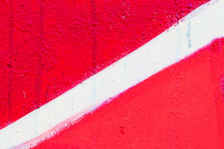 A fragment of colorful graffiti painted on a concrete wall. Abstract urban background for design.