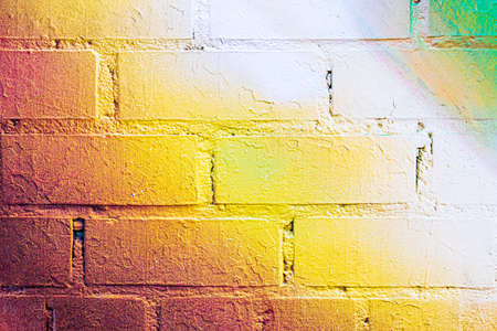 A fragment of colorful graffiti painted on a brick wall. Abstract background for design.