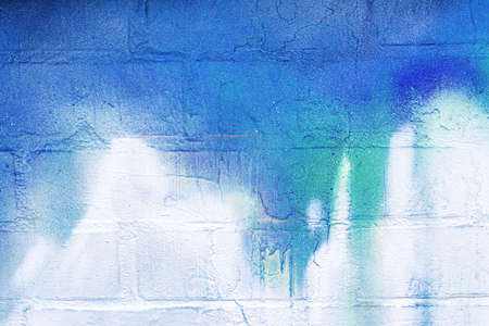 A fragment of colorful graffiti painted on a wall. Abstract urban background for design.