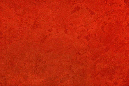 Texture of red decorative plaster or concrete. Abstract grunge background for design. Banco de Imagens