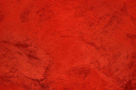 Texture of red decorative plaster or concrete. Abstract grunge background for design. Stockfoto