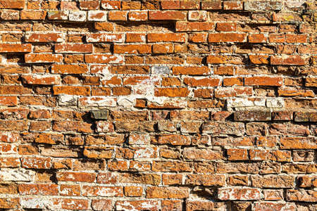 Wall texture from red old damaged bricks. Abstract background for design.