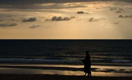 Silhouette of monks on the beach, Thailand. Stock Photo - 9612870