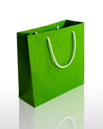 Green paper bag on reflect floor and white background